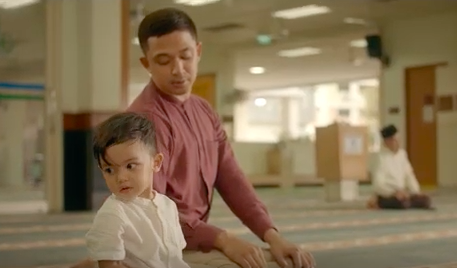 Muslim father Syarif Sleeq and son Umar pray together at mosque