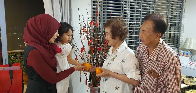 Muslim giving oranges for chinese new year