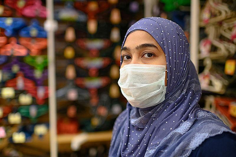 Muslim woman wearing mask due to COVID-19 coronavirus