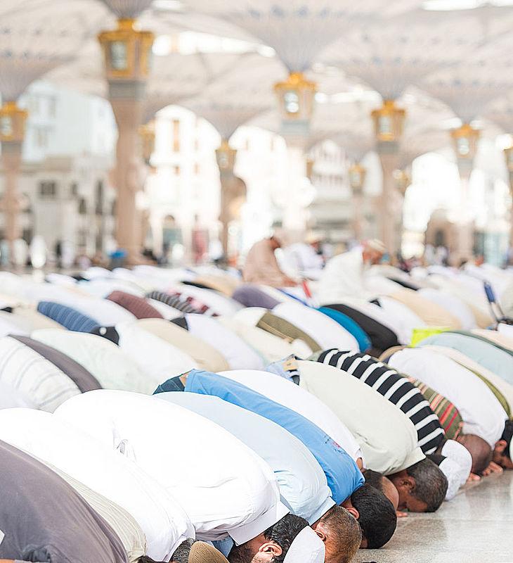 Muslims praying in congregation in Masjid Nabawi in Madinah, Saudi Arabia